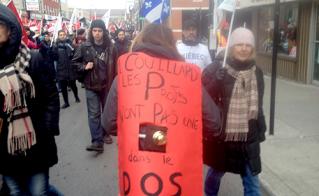 Andréeanne Germain, de l'école Jeanne-Mance, affichait la solution pour débloquer les négociations. © Yves Parenteau